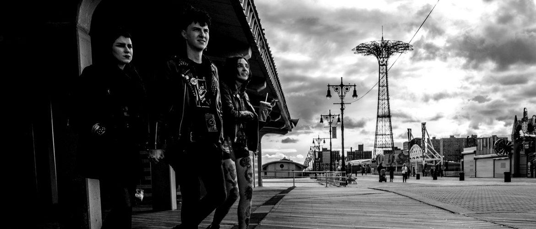 punk fashion teens walking on Coney Island boardwalk